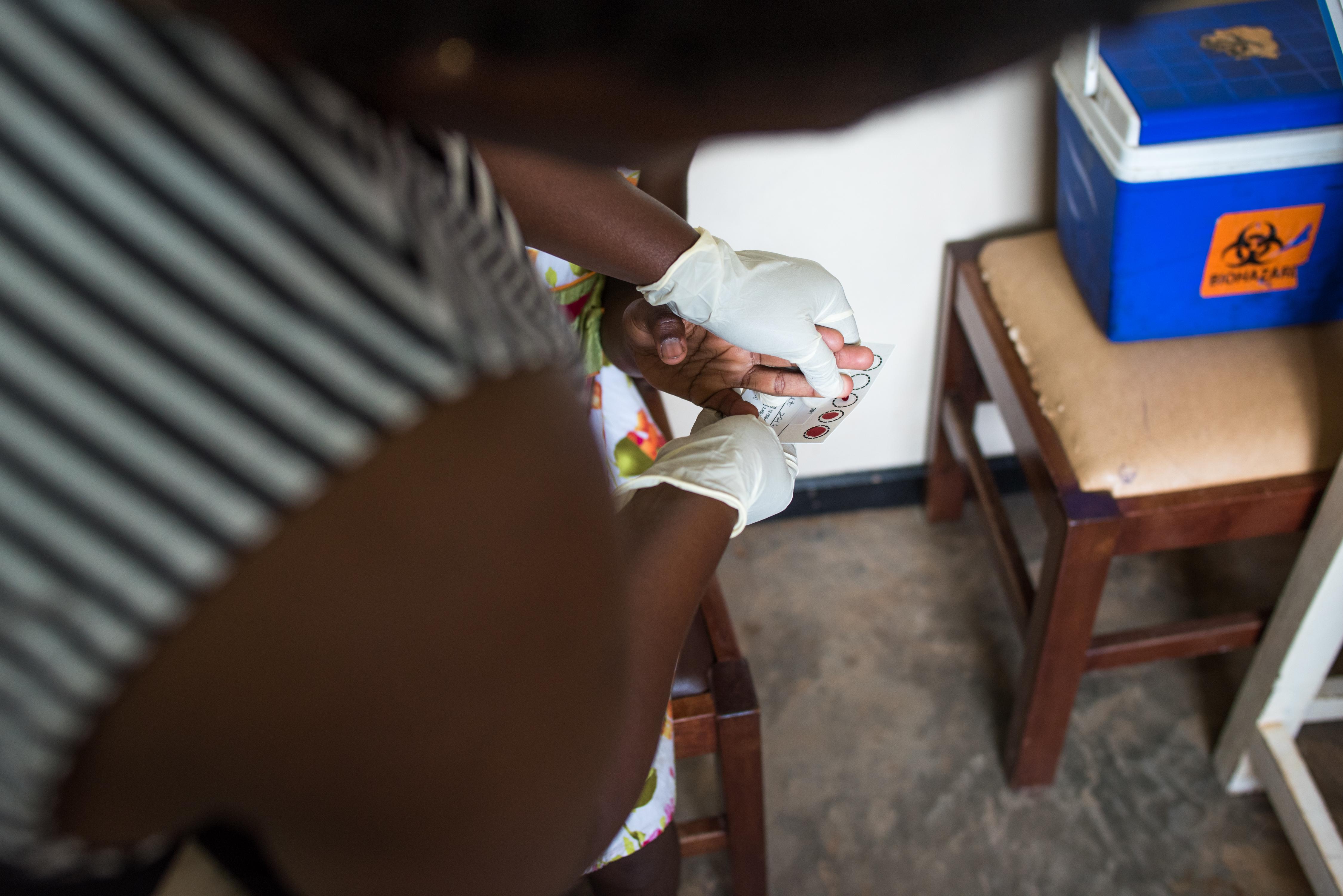 Child's hand getting HIV test