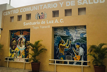 Two murals on side of Community Health Center building in Autlan Mexico