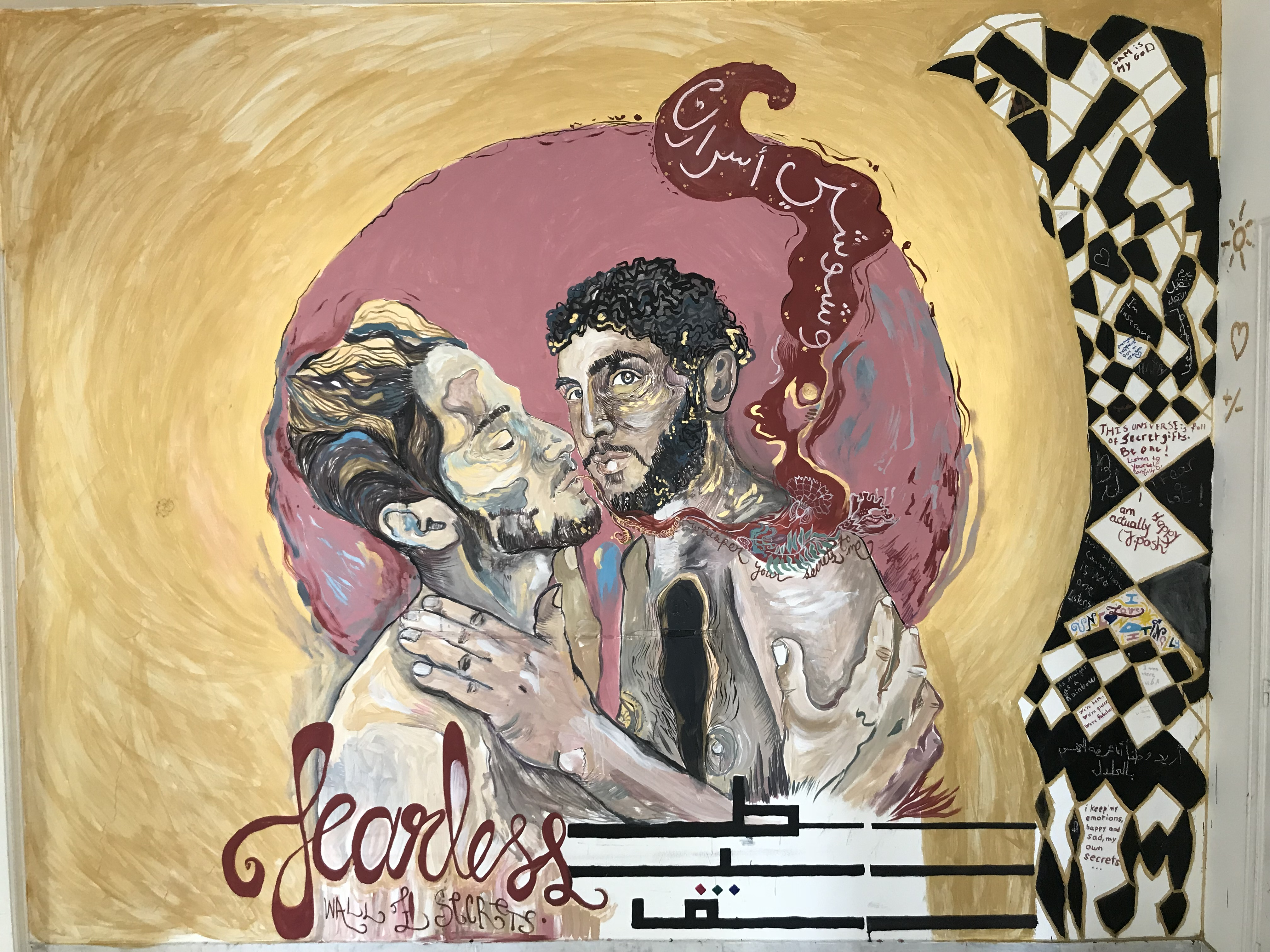 "Wall mural of two men hugging with the word ""fearless"""