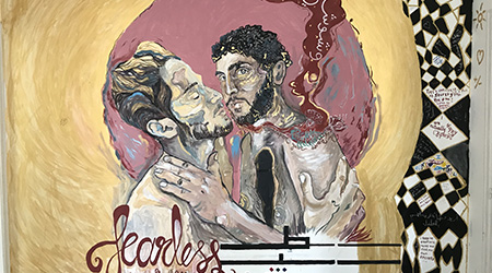 """Wall mural of two men hugging with the word """"fearless"""""""
