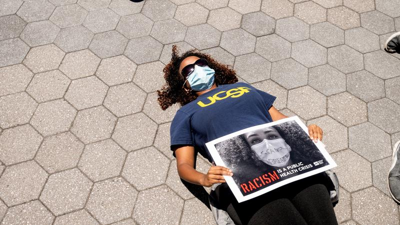 Woman lying down in protest of racism