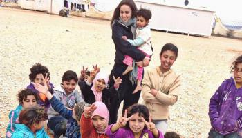 Laila Soudi with children in refugee camp