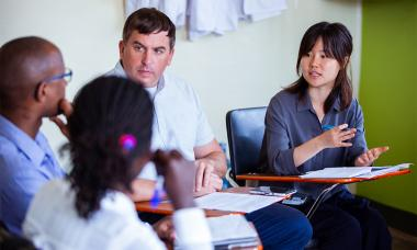 UCSF Institute for Global Health Sciences master's student Annie Ahn talks with health care providers in Uganda