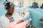 Woman holding newborn in hospital
