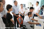 World Bank President Jim Kim discusses hospital information system with the head of Youxi County Hospital in Fujian, China.